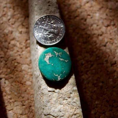 Deep teal-green color cut round from natural Stone Mountain Turquoise