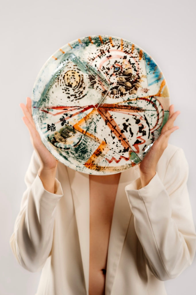 Model holding Bone China Dinner Plate by Delia Prvacki