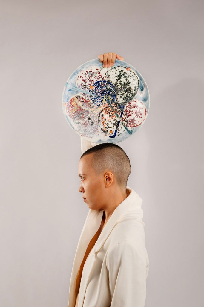 Model holding artwork by Ceramic Artist in Singapore, Delia Prvacki