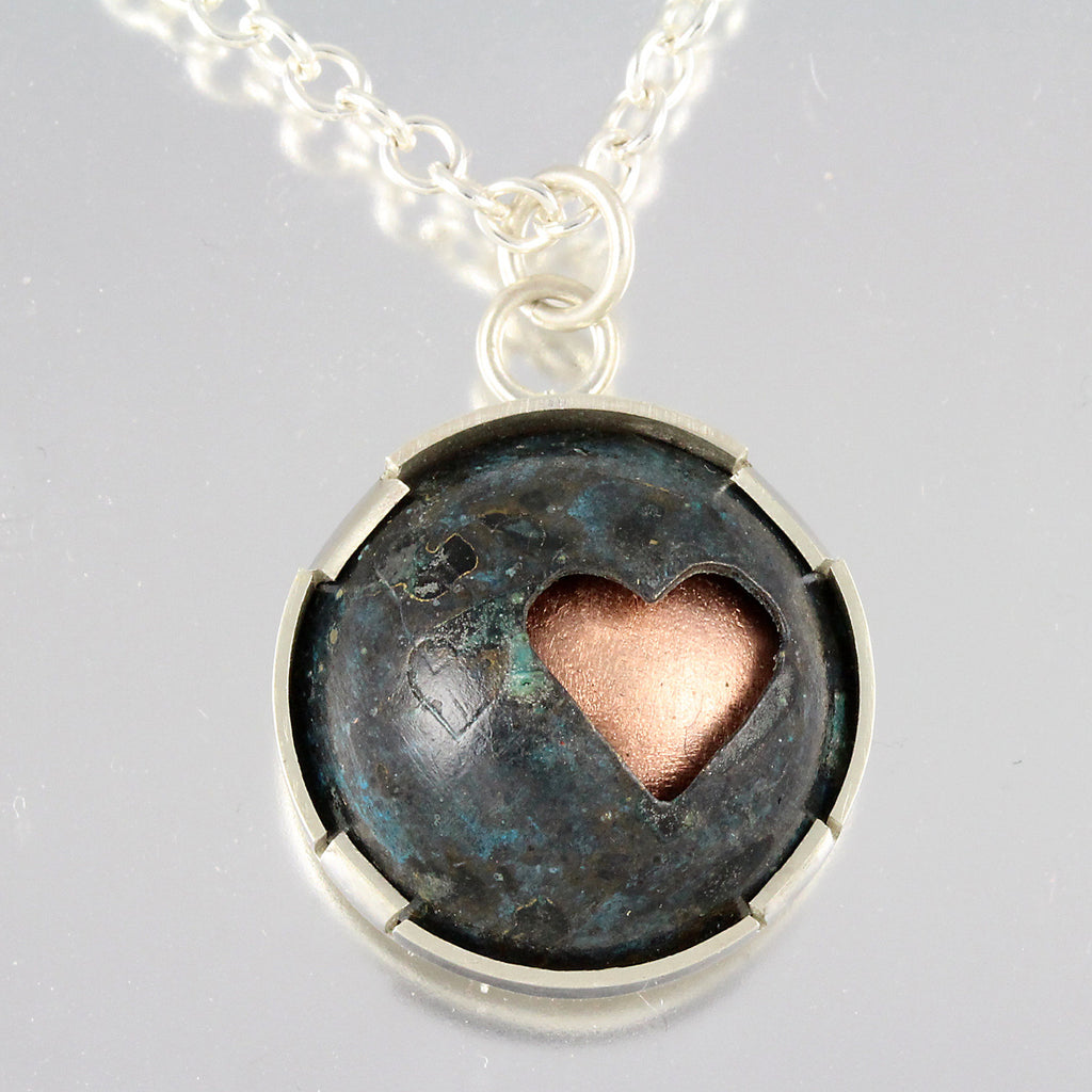 Domed Copper Pendant with Heart Silhouette in Sterling Bezel