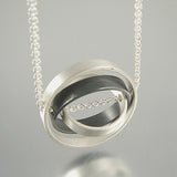 O.C.D. Circle Grayscale Necklace SOS