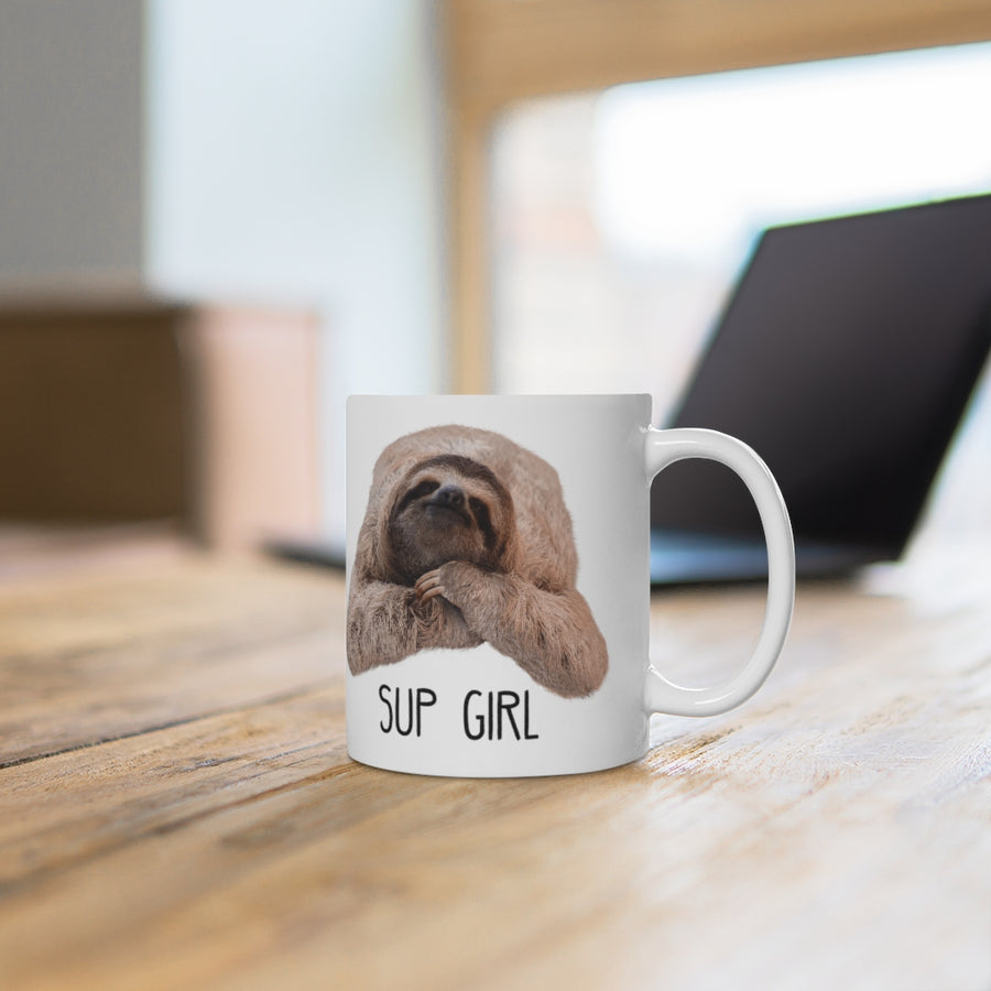 """Sup Girl"" Sloth Mug on desk with laptop"