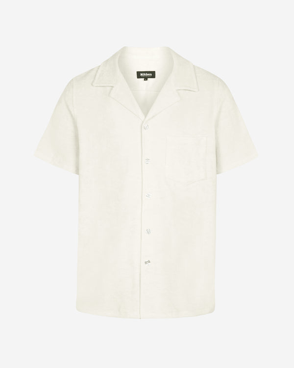 Off white short sleeve terry towelling shirt with white buttons and chest pocket