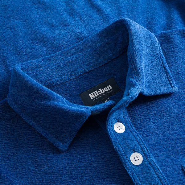 Collar on indigo blue shirt in terry towelling fabric