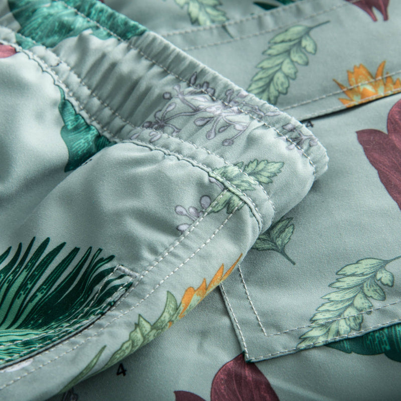 Close up on green flower printed swim trunks