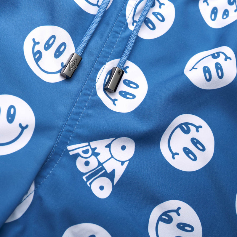 Drawstring waistband on blue swim trunks with white smiley print
