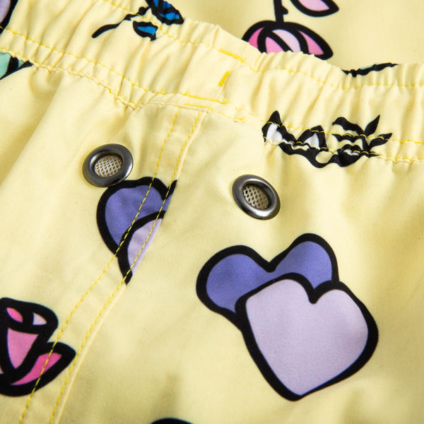 Close up of yellow printed swim trunks