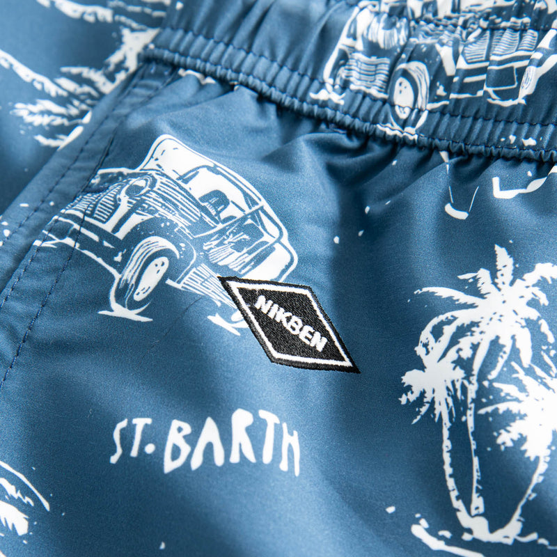 Black logo on blue swim trunks with white print