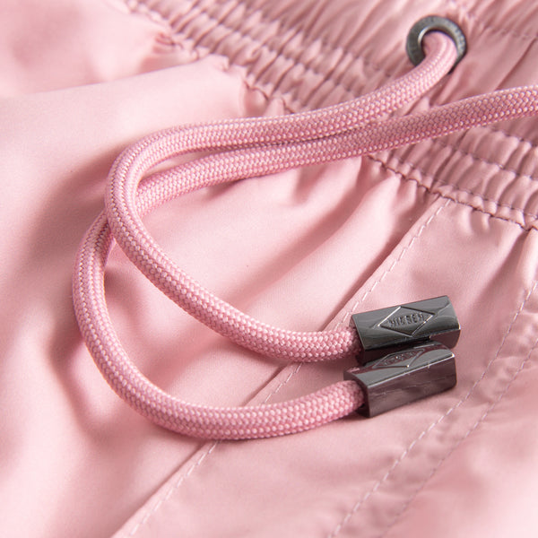 Drawstring on plain pink swim trunks