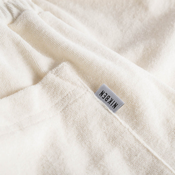 Logo on off white terry towelling shorts