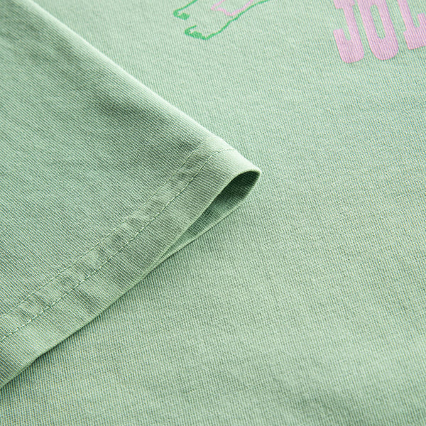 Close up on green t-shirt with pink print