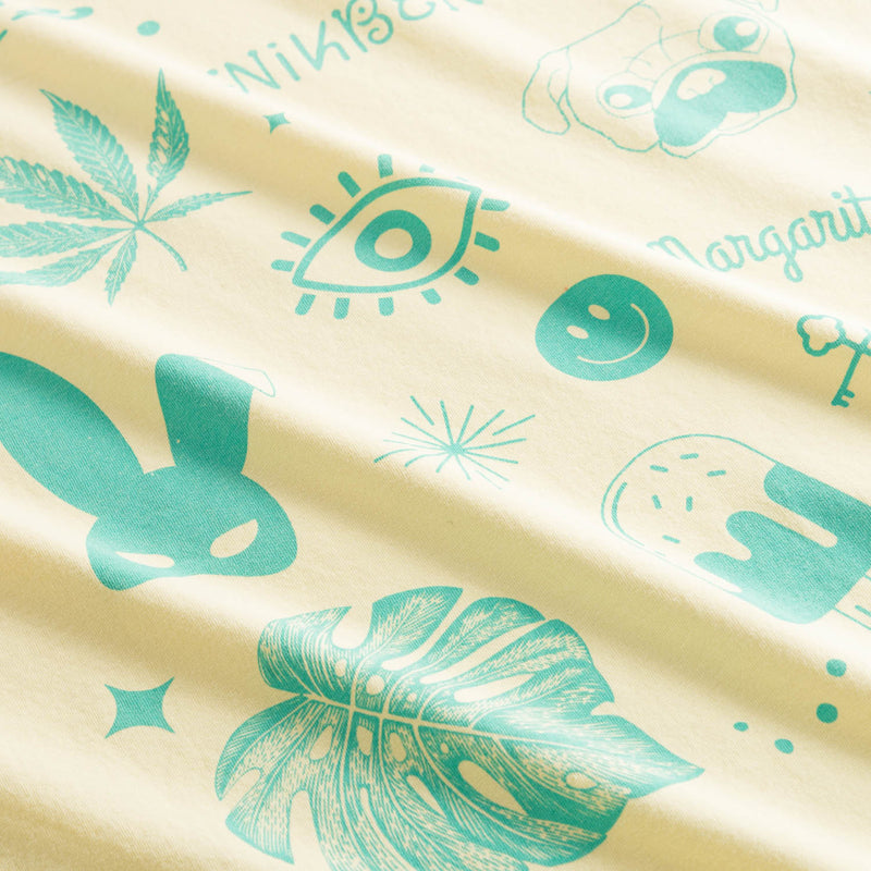 Green  prints on yellow cotton fabric