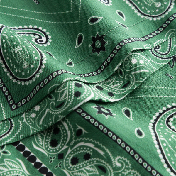 Close up on green patterned vacation pants