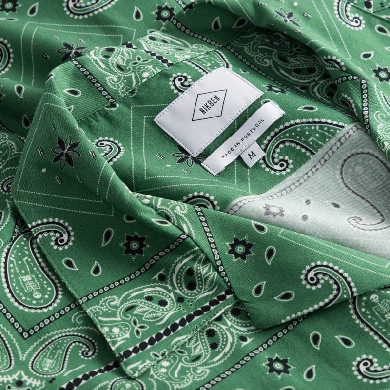 Collar and lable on green vacation shirt