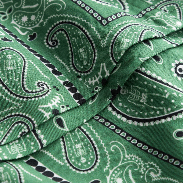 Close up on green vacation shirt