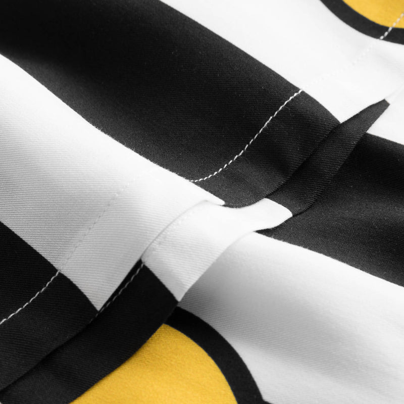 Close up of black-white vacation shirt with lemons