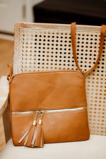 Tassel crossbody purse in brown
