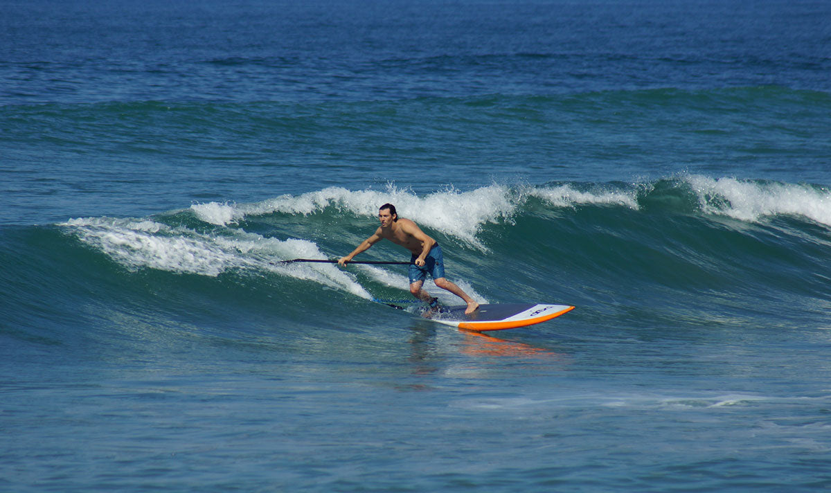 Man Surfing on Paddle Board