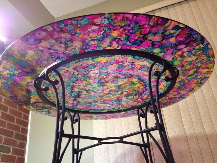 glass table painted with alcohol ink