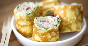 Crepe rolls with ham and cream cheese