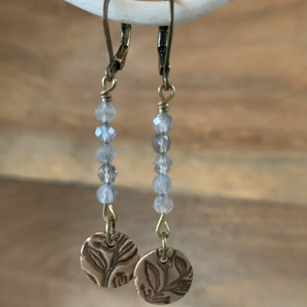 Unique bronze circle earrings with antique button imprint hanging from labradorite.