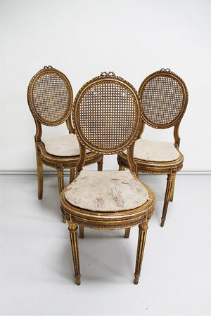 3 gilded chairs