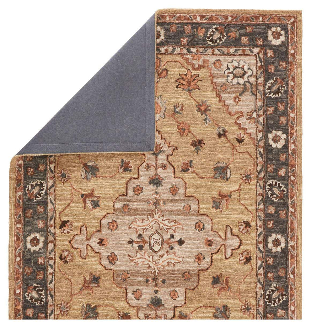 The Jaimie rug showcases a center medallion motif in an earthy palette of tan, gray, brown, and ivory. Inspired by the artistic imperfection of dye-lot changes in perfectly aged wool textiles, the looped pile of this rug features tonal colorway depth and textural dimension.