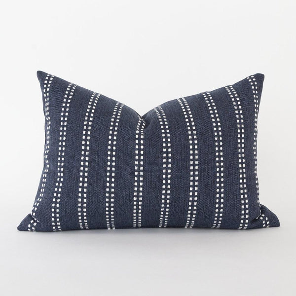 A moody indigo blue and white pillow that will bring graphic impact to your space. Raised dotted stripes offer fun pattern play to this stain-resistant pillow's classic colour palette.  This lumbar shape and size lends itself perfectly to chairs, but would look great on a sofa, bed or bench, too.