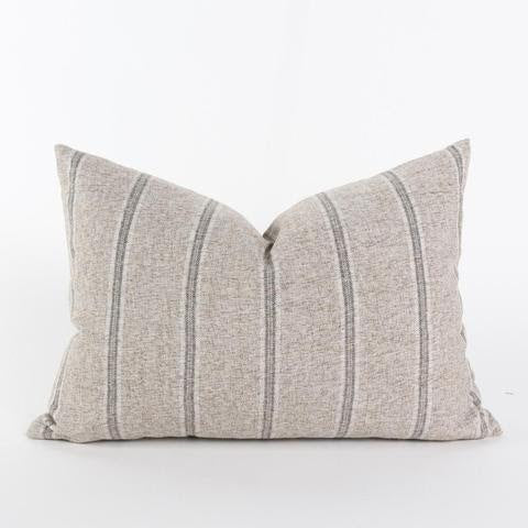 The Isebel Pillow is a medium gray lumbar pillow with slightly warm undertones. This casually cool pillow has wide-set vertical stripes that weave in a full spectrum of gray tones, combining rows of oyster, charcoal and black. Material is flecked with natural spun linen fibers, creating a beautiful, almost brushed quality to the fabric's look and texture. This pillow will add a classic tailored look to any space.