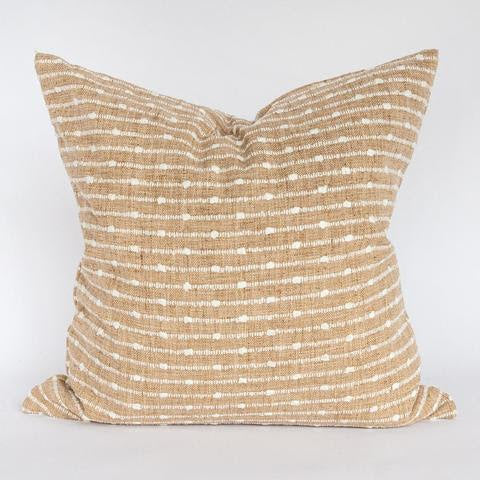 The Abby Pillow is a warm camel color with cream horizontal stripes has a hand loomed, artisanal quality. The raised running stitch stripe is reminiscent of a hobnail weave, and will add a hit of warm, organic texture to your home.