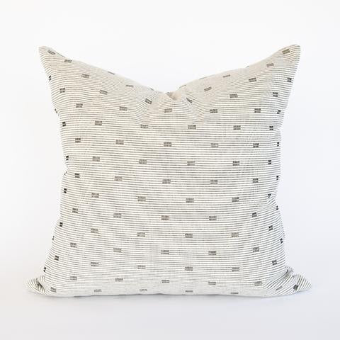 Sam Pillow features a woven cream and black linear design. This striking material has a hand loomed appearance, with vertical threads of black and white weaving through horizontal cotton-colored cords, which creates a soft geometric pattern in tight repetition. This modern, graphic pillow has a handsome quality, that will add a touch of rustic refinement to any space.