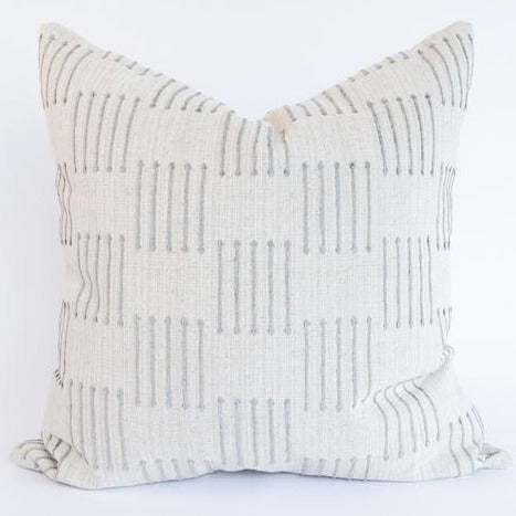 "The Dareios Pillow is featured here in a sandy cream color with dove gray dashes. A simple but dimensional pattern to bring a touch of airy beauty. The Dareios Pillow fabric has a natural and cozy texture that will be the perfect addition to a variety of styles whether you're after earthy or elegant feel. Measures 22"" x 22"""