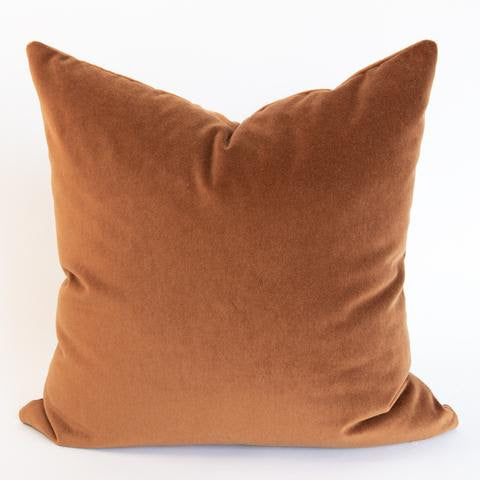 The Jadon Velvet Pillow color is a rusty, burnt orange and is luxurious and super soft. Like a well-aged glass of cognac it's full bodied and will instantly add richness to your space. The versatile tone pairs well with a range of color palettes from deep and earthy to creamy and pretty.
