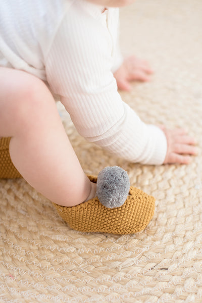 Alimrose Baby Pom Pom Slippers - Butterscotch & Grey lifestyle