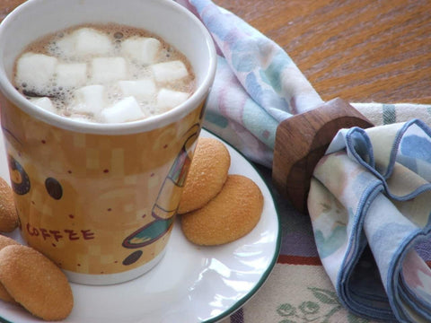 a cup of dissolved hot chocolate bomb