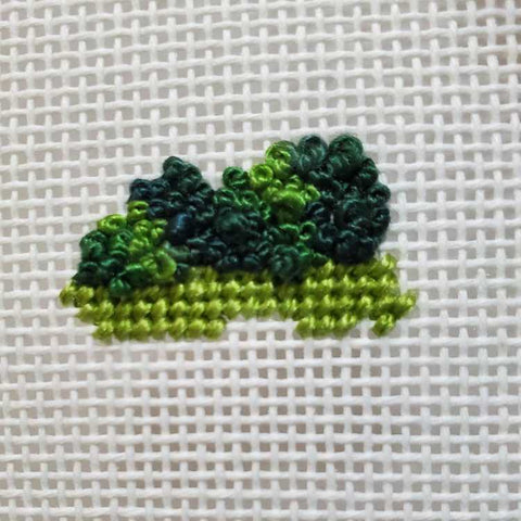 French knots stitched in a variegated needlepoint thread