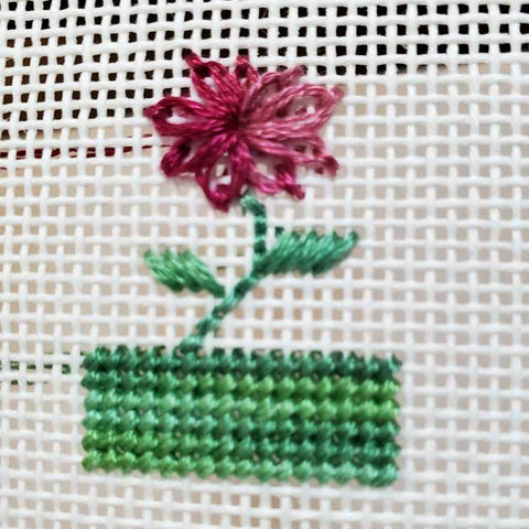 Variegated needlepoint thread and a Lazy Daisy stitch