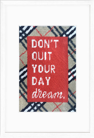 Don't Quit Your Daydream needlepoint kit shown in a white frame.
