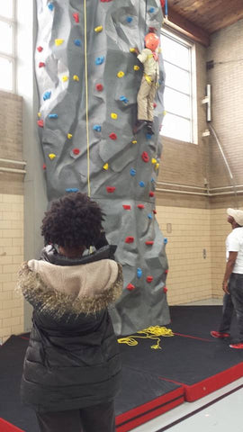 Derrick has a chance to scale a Gecko Modular Climbing Wall in the Rebecca K. Crown Youth Center in Chicago, IL