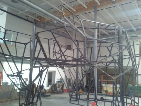 The steel frame that will support the surface panels for the Portland Rock Gym climbing walls are almost finished.
