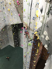 A man climbs one of over a dozen continuous climbable cracks in the ProjectRock Climbing Gym in Oakland Park, FL, near Ft. Lauderdale, FL.