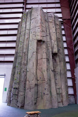 Eldorado Climbing Walls hand-carved and hand-sculpted a 39′ indoor rock climbing wall that resembles Devil's Tower