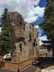 Rock climbers scale the new granite-like climbing wall at Vail.
