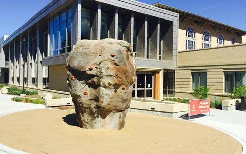 realistic climbing boulder outside of a colle recreation center