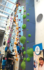 Actor Jason Momoa of Aquaman helps the kids climb during the grand opening