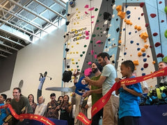 Cutting the ribbon for the opening of the 1Climb VBGC Climbing Wall