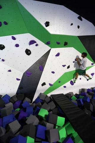 Cimber in the bouldering wall at Spider Monkey Extreme Airsports in Aurora, CO