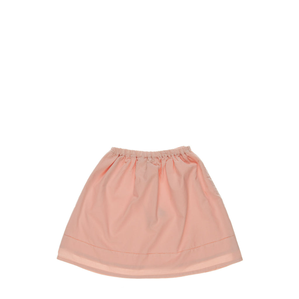IRIS Skirt, back view tailored from an organic cotton in a peach colour. Made by Omibia