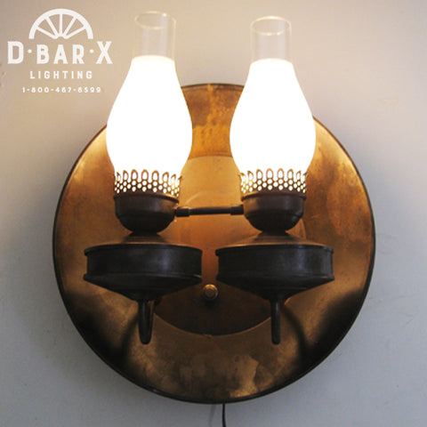 Photo of a Wall Sconce with Two Hurricane Uplights and Gold Pan by D Bar X Lighting.