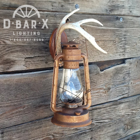 Photo of the DX808 lantern wall sconce with natural antler hook sold by D Bar X Lighting.